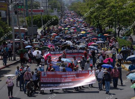 Stock Picture of Teachers march to demand the reinstatement of a dialogue table between the National Coordinator of Education Workers (CNTE) and the President of Mexico, in Tuxtla Gutierrez, Chiapas state, Mexico, 01 June 2021. Some 4,000 teachers marched in the city of Tuxtla Gutierrez, capital of the state of Chiapas, southeast of Mexico. In this possible dialogue, teachers will demand the suspension of the educational reform imposed by the administration of President Enrique Pena Nieto (2012-2018) and that pensions be estimated according to the current minimum wage.