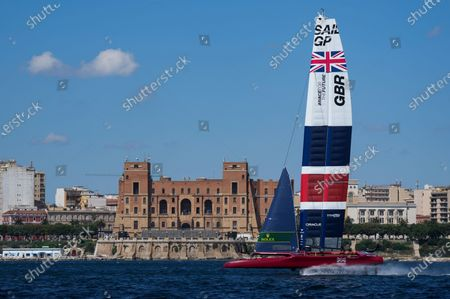Great Britain SailGP Team helmed by interim skipper Paul Goodison sail past the Palazzo del Governo in Taranto during a practice session ahead of Italy SailGP, Event 2, Season 2 in Taranto, Italy.