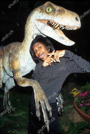 Actress Vanessa Lee Chester posing w. replica of dinosaur for promotion for her film Jurassic Park 2: The Lost World.