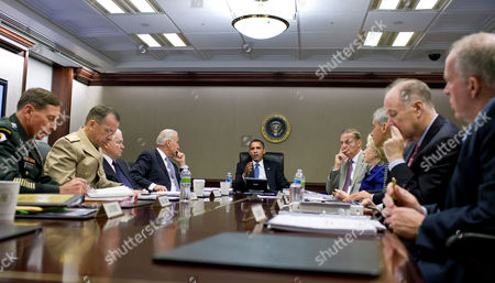 From left: head of US Central Command General David Petraeus, Chairman of the Joint Chiefs of Staff Admiral Michael Mullen, Defence Secretary Robert M. Gates, Vice President Joseph Biden, President Barack Obama, National Security Advisor General James L. Jones, Secretary of State Hillary Rodham Clinton, Chief of Staff Rahm Emanuel, Deputy National Security Advisor Tom Donilon, and John Brennan, Assistant to the President for Homeland Security and Counter-terrorism
