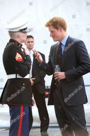 Prince Harry speaks with U.S. Marine veteran Aaron Mankin