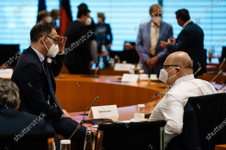 German Foreign Minister Heiko Maas (L) and German Minister of Economy and Energy Peter Altmaier wear face masks, as they talk to each other, during the beginning of the weekly meeting of the German Federal cabinet in the conference hall of the Chancellery in Berlin, Germany, 02 June 2021. The Chancellor and the government ministers are expected to pass a care reform with a raise of a payment according to tariff. It will be financed, among other things, by raising the contribution for childless persons by 0.1 percentage points. This would add 400 million euros a year to the nursing care insurance fund.