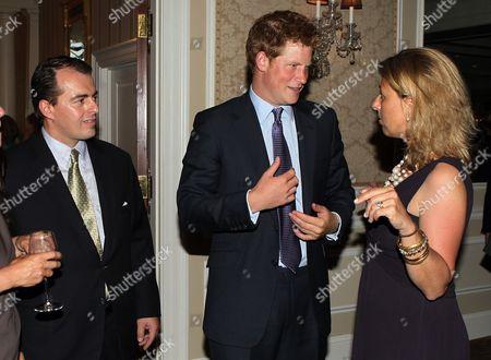 Stock Image of Senior Managing Director of Bank Street Richard Lukaj, Britain's Prince Harry and Sentebale CEO Kedge Martin (R)