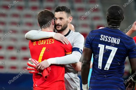 Spurs teammates Ben Davies of Wales and Hugo Lloris of France embrace at the end of the match