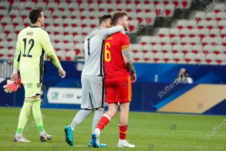 Spurs teammates Hugo Lloris of France and Joe Rodon of Wales at the end of the match
