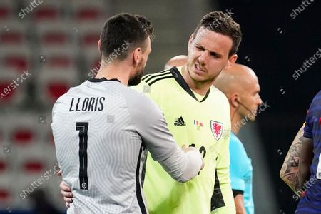 Danny Ward of Wales and Hugo Lloris of France at the end of the match