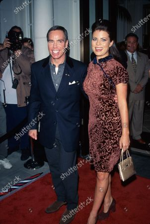 Fashion designer Tommy Hilfiger and actress Yasmine Bleeth at opening of his flagship store.