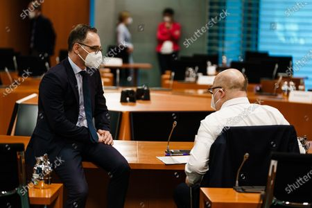 German Foreign Minister Heiko Maas (L) and German Minister of Economy and Energy Peter Altmaier wear face masks, as they talk to each other, during the beginning of the weekly meeting of the German Federal cabinet in the conference hall of the Chancellery in Berlin, Germany, 02 June 2021.