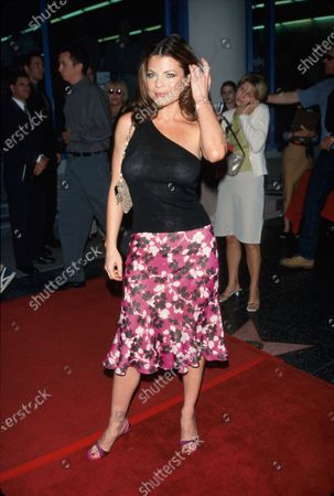 Stock Picture of Actress Yasmine Bleeth (wearing floral design on skirt) at MOVIELINE magazine's Young Hollywood Awards.