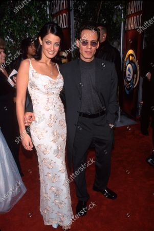 Beauty pageant winner Dayanara Torres and husband, singer Marc Anthony, at Grammy Awards.