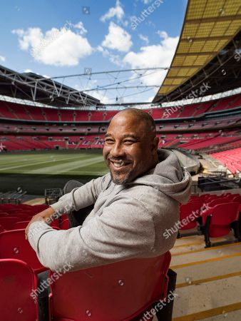 Football legend, John Barnes, is captured in his happy place by iconic photographer Tom Oldham, Wembley Stadium is one of hundreds of venues taking part in The National Lottery Open Week & Cinema Weekend, offering National Lottery players free entry and special offers to say thank you for the £30m they raise for good causes each week. Visit www.NationalLotteryUnlocked.com to find out more
