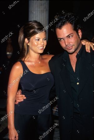 Actors Yasmine Bleeth and Richard Grieco at party for DETAILS magazine.