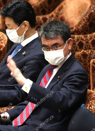 Stock Picture of Japanese Administrative Reform Minister Taro Kono raises his hand to answer a question at Lower House's cabinet committee session at the National Diet in Tokyo on Wednesday, June 2, 2021.