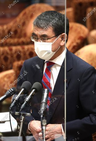 Japanese Administrative Reform Minister Taro Kono answers a question at Lower House's cabinet committee session at the National Diet in Tokyo on Wednesday, June 2, 2021.