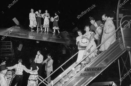 Mitch Miller (on ramp top R) with Goddard Lieberson of Columbia records (on ramp top L) and other cast members entertaining on the stage of the Grand Ole Opry.