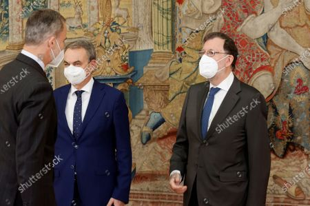 Stock Photo of King Felipe VI (L) chats with former Spanish Prime Ministers Jose Luis Rodriguez Zapatero (2-L) and Mariano Rajoy (R) during the annual meeting of the Royal Elcano Institute patronage in El Pardo Palace in Madrid, Spain, 02 June 2021.