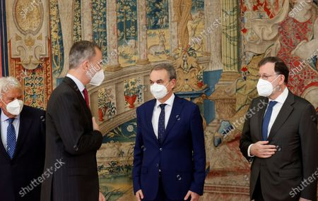 King Felipe VI (2-L) chats with former Spanish Prime Ministers Jose Luis Rodriguez Zapatero (2-R), Mariano Rajoy (R) and Felipe Gonzalez (L) during the annual meeting of the Royal Elcano Institute patronage in El Pardo Palace in Madrid, Spain, 02 June 2021.