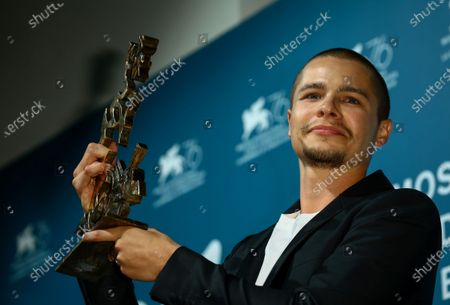 Toby Wallace poses with the Marcello Mastroianni Award for Best Young Actor