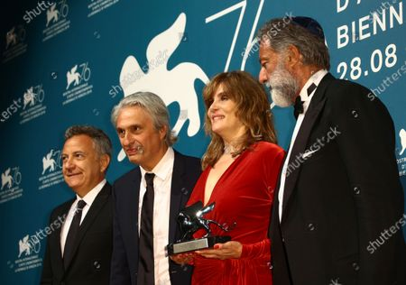 Stock Image of French actress Emmanuelle Seigner, flanked by (FromL) Italian producer Paolo Del Brocco, French producer Alain Goldman and Italian producer Luca Barbareschi, holds on behalf of Polish French director Roman Polanski the Silver Lion award