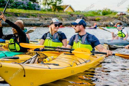 Norwegian Crown Prince Haakon (R) and Crown Princess Mette-Marit (C) kayak in the summer heat during a tour in the Oslo Fjord, 02 June 2021. The Crown Prince and Crown Princess contacted 'Norsk Friluftsliv' who invited young people from the Oslo Kayak Club.