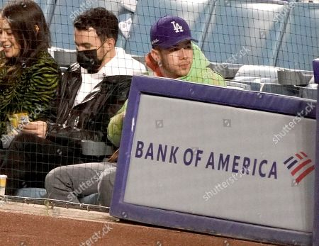 Kevin Jonas and Nick Jonas at the Los Angeles Dodgers Vs The St Louis Cardinals Baseball Game