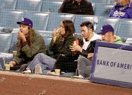 Stock Image of Kevin Jonas and Nick Jonas at the Los Angeles Dodgers Vs The St Louis Cardinals Baseball Game