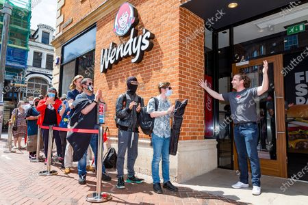 Stock Image of Michael Clarke, UK Operations Director for Wendy's officially opens the restaurant.