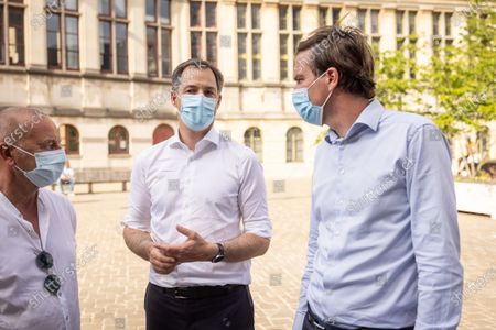 Stock Image of An unidentified man, Prime Minister Alexander De Croo and Gent mayor Mathias De Clercq pictured during a vigil for the 14-year old girl who committed suicide after a gang rape, in the center of Gent, Wednesday 02 June 2021. About two weeks ago, the 14-year-old girl was the victim of a gang rape at the cemetery Westerbegraafplaats. She committed suicide four days later, after a video of the attack by five men was leaked on social media.
