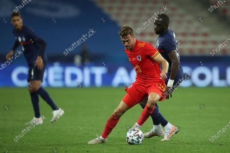 Wales' Aaron Ramsey, left, is challenged by France's Moussa Sissoko during the international friendly soccer match between France and Wales at the Allianz Riviera stadium in Nice, France