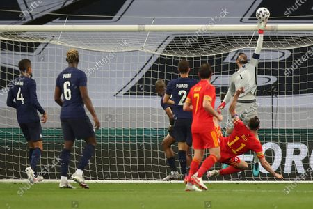 France's goalkeeper Hugo Lloris, right, makes a save in front of Wales' Gareth Bale during the international friendly soccer match between France and Wales at the Allianz Riviera stadium in Nice, France