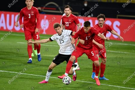 Germany's Thomas Muller fights for the ball with Denmark's Joakim Maehle, 2nd right, during the international friendly soccer match between Germany and Denmark at the Tivoli Stadion Tirol in Innsbruck, Austria