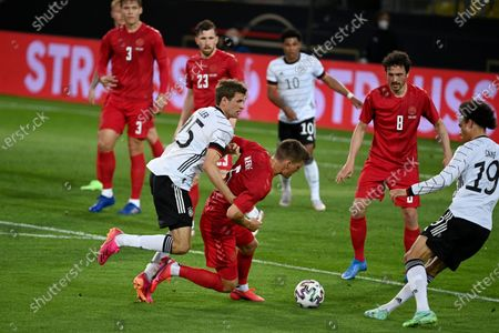 Germany's Thomas Muller, center left, fights for the ball with Denmark's Joakim Maehle, center, during the international friendly soccer match between Germany and Denmark at the Tivoli Stadion Tirol in Innsbruck, Austria