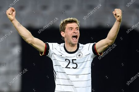 Germany's Thomas Muller celebrates after teammate Florian Neuhaus scored the opening goal during the international friendly soccer match between Germany and Denmark at the Tivoli Stadion Tirol in Innsbruck, Austria