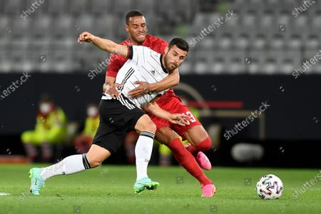 Stock Photo of Denmark's Mathias Jorgensen, left, fights for the ball with Germany's Kevin Volland during the international friendly soccer match between Germany and Denmark at the Tivoli Stadion Tirol in Innsbruck, Austria