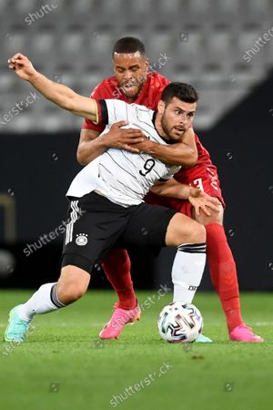 Denmark's Mathias Jorgensen, left, fights for the ball with Germany's Kevin Volland during the international friendly soccer match between Germany and Denmark at the Tivoli Stadion Tirol in Innsbruck, Austria