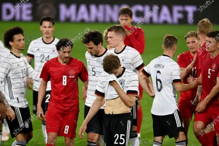 Germany's Thomas Muller, foreground center, leaves the field at the end of the international friendly soccer match between Germany and Denmark at the Tivoli Stadion Tirol in Innsbruck, Austria