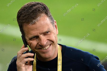 Germani national team director Oliver Bierhoff speaks on the phone by the pitch before the international friendly soccer match between Germany and Denmark at the Tivoli Stadion Tirol in Innsbruck, Austria