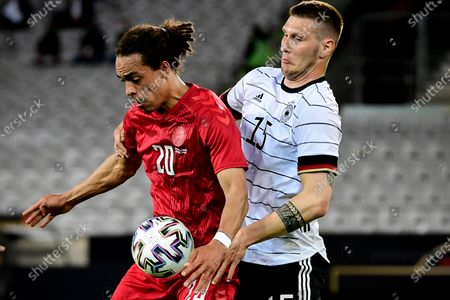 Stock Photo of Germany's Niklas Suele (R) in action against Denmark's Yussuf Poulsen (L) during the International Friendly soccer match between Germany and Denmark in Innsbruck, Austria, 02 June 2021.
