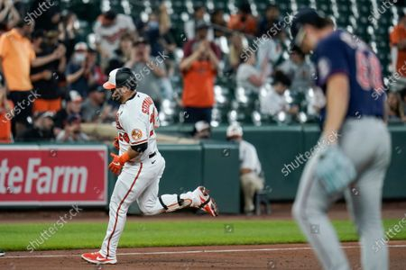 Baltimore Orioles' DJ Stewart, left, runs the bases after hitting a two-run home run against Minnesota Twins starting pitcher Randy Dobnak, right, during the fifth inning of a baseball game, in Baltimore. Orioles' Freddy Galvis scored on the home run