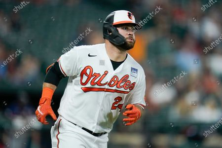 Stock Picture of Baltimore Orioles' DJ Stewart watches his ball as he hits a two-run home run against Minnesota Twins starting pitcher Randy Dobnak during the fifth inning of a baseball game, in Baltimore. Orioles' Freddy Galvis scored on the home run