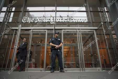 A police officer stands outside The New York Times building in New York. The Trump Justice Department secretly obtained the phone records of four New York Times journalists as part of a leak investigation, the newspaper said