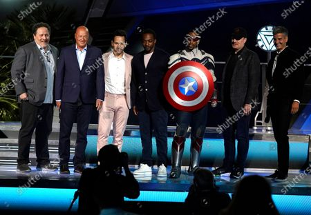 Jon Favreau, from left, Disney CEO Bob Chapek, Paul Rudd, Anthony Mackie, a Captain America character, Marvel President Kevin Feige and Josh D'Amaro, chairman, Disney parks, experiences and products, appear on stage at the Avengers Campus dedication ceremony at Disney's California Adventure Park, in Anaheim, Calif