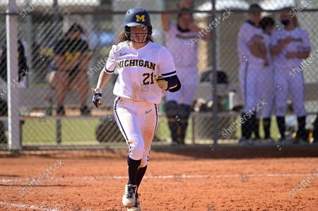 Michigan's Natalia Rodriguez (21) jogs to first base during an NCAA college softball game against Wisconsin, in Leesburg, Fla