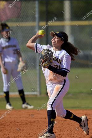 Michigan infielder Natalia Rodriguez (21) throws during an NCAA college softball game against Wisconsin, in Leesburg, Fla