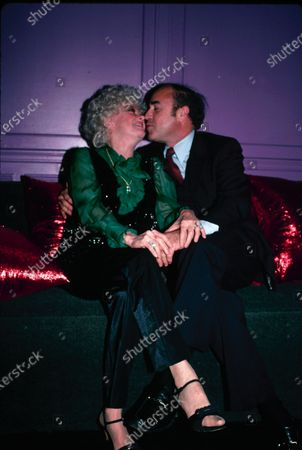 UNITED STATES - 30th October 1981: American actress and comedienne Phyllis Diller (1917 - 2012) kissing Dr Donald Levy during a Halloween party at Les Mouches in New York.