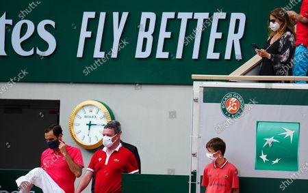 Mirka Federer films Roger Federer after a break between sets 3 and 4 in the second round