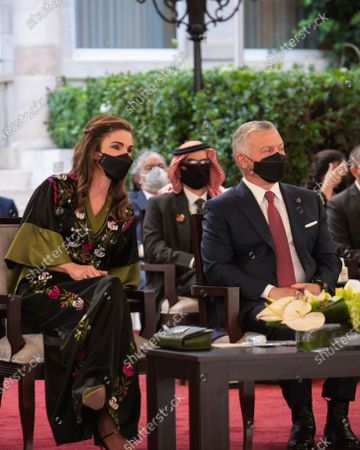 His Majesty King Abdullah II, and Her Majesty Queen Rania Al wearing face masks..They were attending the 75th Independence Day of the Hashemite Kingdom of Jordan at Raghadan Palace