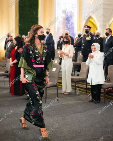 Stock Photo of Queen Rania wearing face mask attending the 75th Independence Day of the Hashemite Kingdom of Jordan at Raghadan Palace