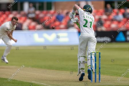 Stock Image of Sam Evans defends a short ball from Josh Shaw during Day 1 of the LV= Insurance County Championship match between Leicestershire County Cricket Club and Gloucestershire County Cricket Club at the Uptonsteel County Ground, Leicester