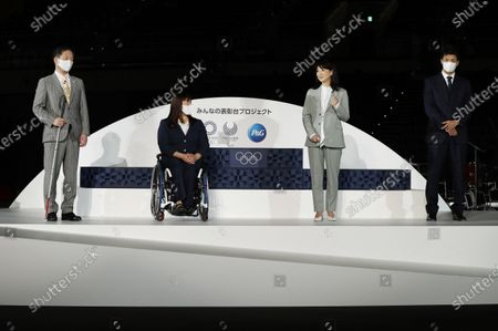 Japanese Olympians and Paralympians left to right; Junichi Kawai, Kuniko Obinata, Kyoko Iwasaki and Ryota Murata attend an unveiling event for the elements that will be used during the victory ceremonies at the Tokyo 2020 Olympic and Paralympic Games at the Ariake Arena, in Tokyo